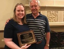 Drew Hickey receiving an award with Jon Robinson.