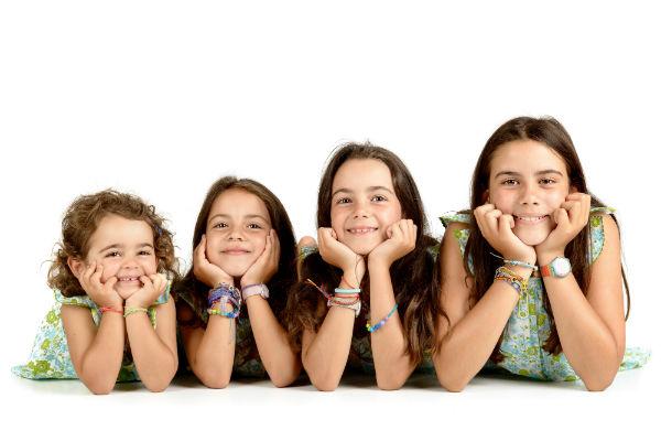 Four girl siblings laying on floor