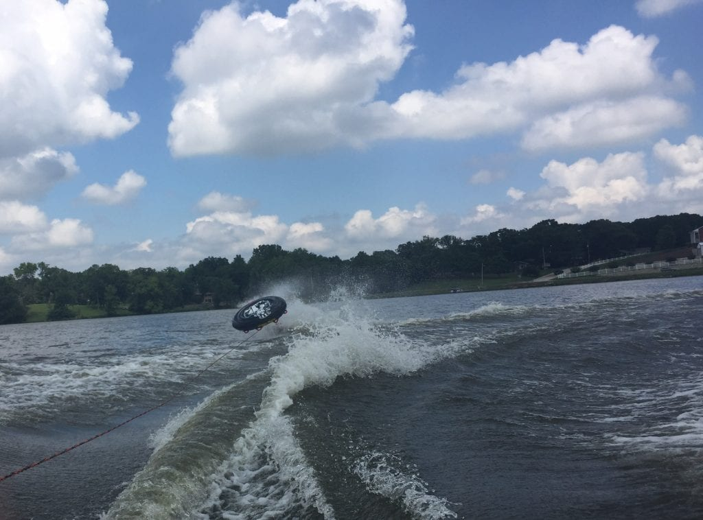Person Falling off Tube on Lake