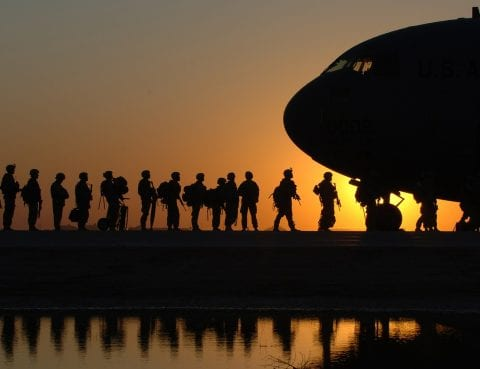 Solders walking to plane